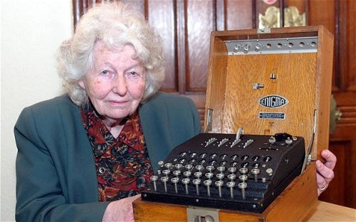 Mavis Batey with an Enigma Machine