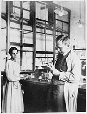 Lise Meitner and Otto Hahn in their laboratory. Source: Wikimedia Commons